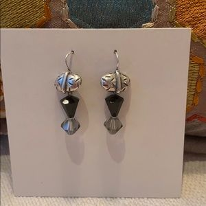 Silver earrings on wires.